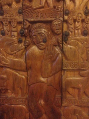 """Detail from Carved wood cart is titled Cree Prophesy, wood, steel, rubber, 50 x 27 """", 2001"""